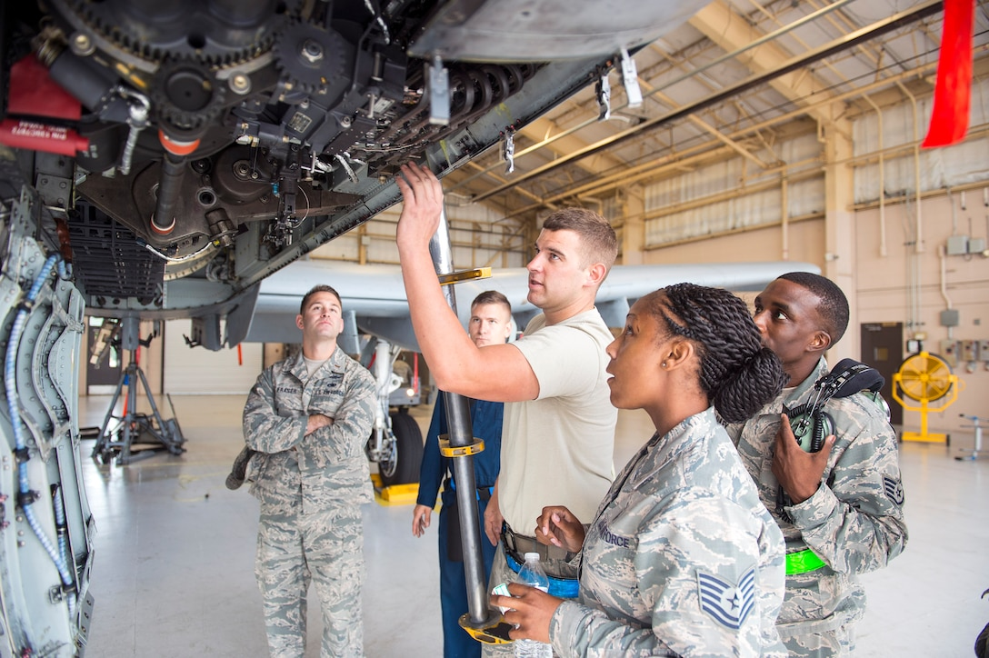 U.S. Air Force Senior Airman Joshua Abbott, 74th Aircraft Maintenance Unit aircraft armament systems technician, explains to Tech. Sgt. Netasha Hutto-Harris, 23d Medical Support Squadron NCO in charge of medical evaluation boards, the weaponry aspects of an A-10C Thunderbolt II, Oct. 6, 2016, at Moody Air Force Base, Ga. Hutto-Harris says she appreciated the chance to glimpse into the life of a maintainer. (U.S. Air Force photo by Airman 1st Class Greg Nash)