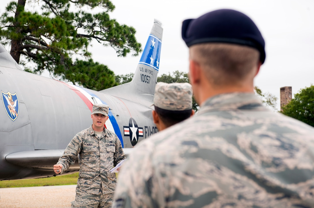 U.S. Air Force 2nd Lt. Ryan Noblin, 75th Aircraft Maintenance Unit officer in charge, briefs Airmen about various static displays in the President George W. Bush Airpark, Oct. 6, 2016, at Moody Air Force Base, Ga. The briefing focused on the maintenance innovations through the years on Moody's aircraft from the Curtiss P-40 Warhawk to the A-10C Thunderbolt II. (U.S. Air Force photo by Airman 1st Class Greg Nash)