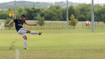 U.S. Air Force Staff Sgt. Nelson Hernandez, 317th Aircraft Maintenance Squadron avionics technician, kicks a soccer ball at the South Texas Area Regional Soccer Complex in San Antonio, Texas, Sept. 5, 2016. During the Defender's National Military Soccer Tournament, the Dyess Varsity soccer team played a total of eight games against 45 other teams from various branches of service. (Courtesy photo by Patricia Moreno)
