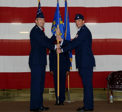Lt. Col. Cory Christoffer, right, 47th Student Squadron commander, poses for a photo with Col. Bryan Runkle, 47th Operations Group commander, during a change of command at Laughlin Air Force Base, Texas, Oct. 7, 2016. Christoffer came to the 47th STUS from his previous position as the chief of safety, 47th Flying Training Wing, at Laughlin. (U.S. Air Force photo/Senior Airman Ariel D. Partlow)