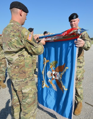 201st Military Intelligence Battalion Command Sgt. Maj. Jason Davis (right) joins Lt. Col. David Violand (left), 201st Military Intelligence Battalion commander, in casing the battalion's colors.
