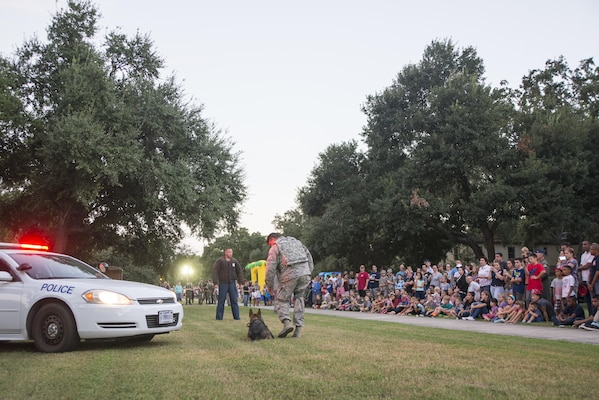 Members from the 902nd Security Forces Squadron give a military working dog demonstration during National Night Out at Joint Base San Antonio-Randolph Oct. 4, 2016. The 902nd SFS is home to six MWDs, each has explosives and narcotics training as part of their weekly duties.