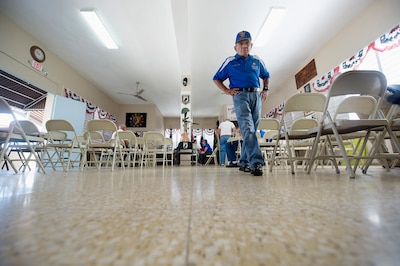 Vietnam and Korea War veteran Army Reservist Gilberto Luciano Padilla walks inside the American Legion in Cabo Rojo, Puerto Rico, Aug. 10, 2016. DoD photo by EJ Hersom