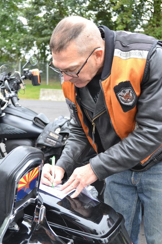 Master Sgt. Stuart Peters, maintenance supervisor for the 80th Training Command (TASS), checks everything on his motorcycle at the command's Family Programs Center in Richmond, Va., as he prepares for the motorcycle mentorship ride in honor of Sgt. Scott McGinnis on Oct. 6, 2016. McGinnis, 22, died in a motorcycle accident July 4, 2016 in Centre, Ala., where he was struck by another vehicle.