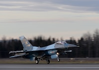 A U.S. Air Force F-16 Fighting Falcon assigned to the 18th Aggressor Squadron takes off from Eielson Air Force Base, Alaska, Oct. 10, 2016, for the first combat training mission of RED FLAG-Alaska (RF-A) 17-1. The average Aggressor pilot has at least 1,000 fighter hours and hundreds of hours of studying to become experts in enemy tactics used to train U.S. Air Force, joint and coalition partners during U.S. Pacific Air Forces commander-directed RF-A exercises. (U.S. Air Force photo by Master Sgt. Karen J. Tomasik)