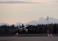 A U.S. Air Force F-16 Fighting Falcon assigned to the 18th Aggressor Squadron takes off from Eielson Air Force Base, Alaska, with afterburners engaged Oct. 10, 2016, for the first combat training mission of RED FLAG-Alaska (RF-A) 17-1. The average Aggressor pilot has at least 1,000 fighter hours and hundreds of hours of studying to become experts in enemy tactics used to train U.S. Air Force, joint and coalition partners during U.S. Pacific Air Forces commander-directed RF-A exercises. (U.S. Air Force photo by Master Sgt. Karen J. Tomasik)