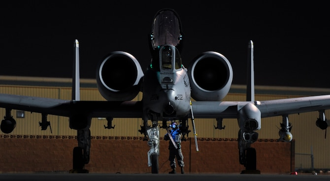 An Airman assigned to 355th Aircraft Maintenance Squadron, Davis-Monthan Air Force Base, Ariz., prepares an A-10 Thunderbolt II to participate in Green Flag 17-01 at Nellis Air Force Base, Nev., Oct. 4, 2016. During exercise execution, Green Flag staff direct, monitor and instruct visiting units in the conduct of air operations in support of ground forces. (U.S. Air Force photo by Airman 1st Class Kevin Tanenbaum/Released)