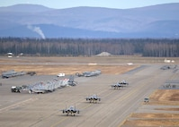 Republic of Korea Air Force (ROKAF) F-15K Slam Eagle multi-role fighter aircraft taxi toward their ramp space on the Eielson Air Force Base, Alaska, flight line Oct. 10, 2016, as a U.S. Air Force HH-60 Pave Hawk helicopter assigned to the 210th Rescue Squadron prepares for its own mission after the first RED FLAG-Alaska (RF-A) 17-1 combat training sortie ended. RF-A is a series of Pacific Air Forces commander-directed field training exercises vital to maintaining peace and stability in the Indo-Asia-Pacific region, and providing U.S. units and partner nation forces the opportunity to sharpen their combat skills and strengthen interoperability inside more than 67,000 square miles of airspace in the Joint Pacific Alaska Range Complex. (U.S. Air Force photo by Master Sgt. Karen J. Tomasik)