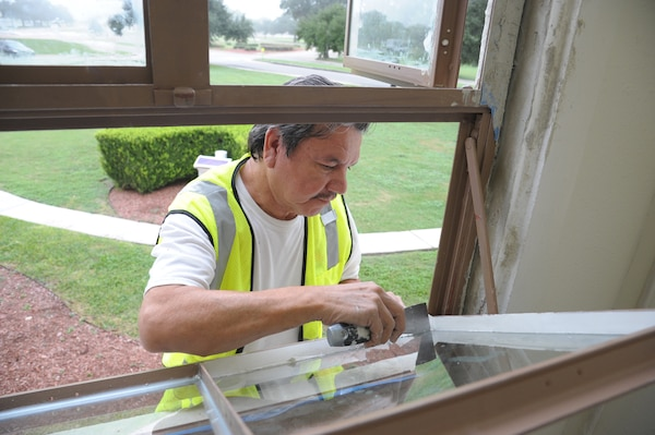 Eddie Contreras glazes a window at the Joint Base San Antonio-Randolph Taj Mahal, during its renovation process Oct. 6, 2016.  The renovation is part of a $10 million project designed the improve the Taj Mahal, which houses the headquarters for the 12th Flying Training Wing and the 12th Mission Support Group.