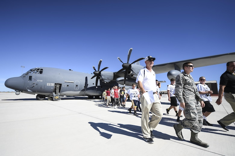 Students and teachers tour a static display of a C130 during the fourth annual New Mexico Aviation Aerospace Association Career Expo Oct. 6, 2016 at Holloman Air Force Base N.M. About 2,500 middle school through college-level students from across New Mexico came out to learn about the science, technology, engineering and mathematics fields. The goal of STEM is to motivate and educate students by giving them a taste of what aviation and aerospace engineering is all about. These STEM events also get the students talking to people who are working directly in STEM industries.  (U.S. Air Force photo by Staff Sgt. Stacy Jonsgaard)