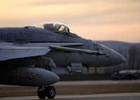 A pilot assigned to Marine Fighter Attack Squadron (VMFA) 232 out of Marine Corps Air Station Miramar, Calif., taxis his F/A-18C Hornet aircraft down the Eielson Air Force Base, Alaska, flight line as the sun rises Oct. 10, 2016, during RED FLAG-Alaska (RF-A) 17-1. RF-A is a series of Pacific Air Forces commander-directed field training exercises for U.S. and partner nation forces, which enables U.S. Marines in units like VMFA-232 to prepare for future combat and contingency operations in a realistic threat environment inside the largest instrumented air, ground and electronic combat training range in the world. (U.S. Air Force photo by Master Sgt. Karen J. Tomasik)