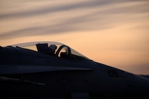 A pilot assigned to Marine Fighter Attack Squadron 232 out of Marine Corps Air Station Miramar, Calif., taxis his F/A-18C Hornet aircraft down the Eielson Air Force Base, Alaska, flight line as the sun rises Oct. 10, 2016, during RED FLAG-Alaska (RF-A) 17-1. The Joint Pacific Alaska Range Complex provides more than 67,000 square miles of realistic training environment and allows commanders to train for full spectrum engagements, ranging from individual skills to complex, large-scale joint engagements. (U.S. Air Force photo by Master Sgt. Karen J. Tomasik)