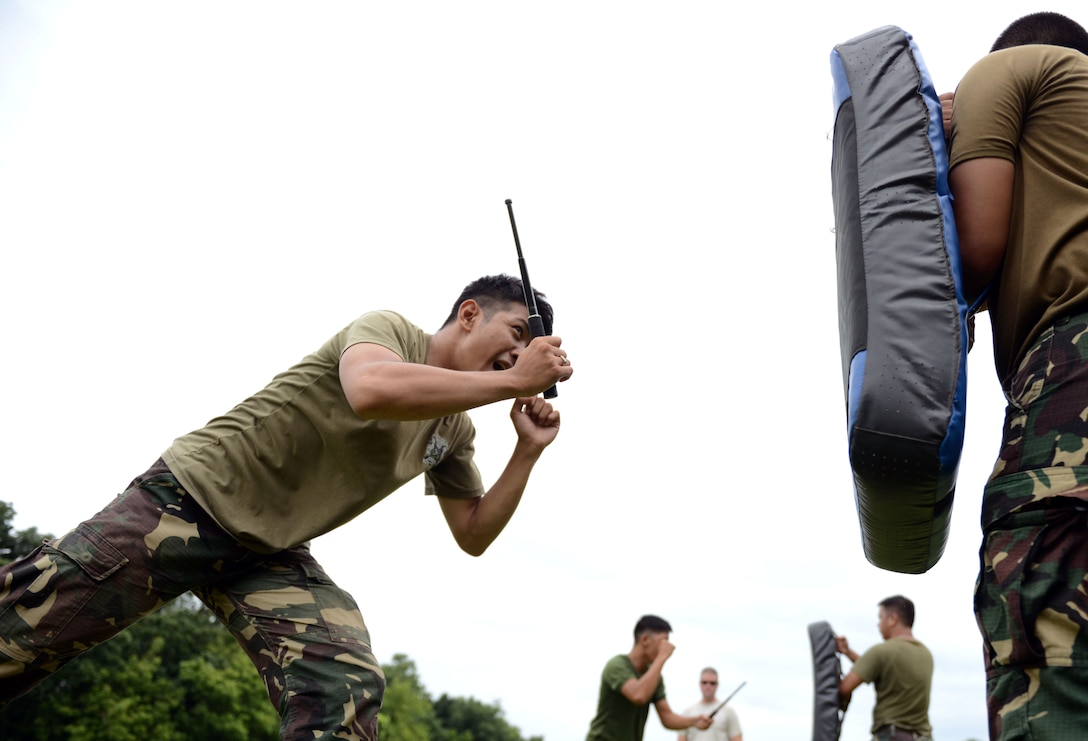 A Philippine Air Force military police office participates in baton practice, a nonlethal means of subduing an aggressor, during a subject matter expert exchange with the United States as part of the current iteration of U.S. Pacific Command's Air Contingent at Brigadier General Benito N Ebuen Air Base, Lapu-Lapu City, Philippines, Oct. 4, 2016. The Air Contingent is helping build the capacity of the Philippine Air Force and increases joint training, promotes interoperability and provides greater and more transparent air and maritime situational awareness to ensure safety for military and civilian activities in international waters and airspace. Its missions include air and maritime domain awareness, personnel recovery, combating piracy, and assuring access to the air and maritime domains in accordance with international law. (U.S. Air Force photo by Capt. Mark Lazane)