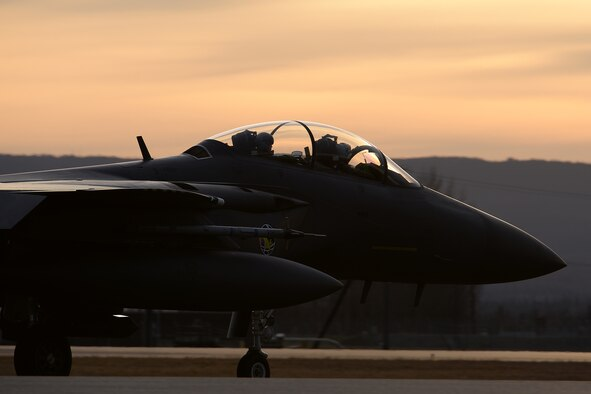 A Republic of Korea Air Force (ROKAF) F-15K Slam Eagle multi-role fighter aircraft crewed by a pilot and weapons officer taxis down the Eielson Air Force Base, Alaska, flight line as the sun rises Oct. 10, 2016, during RED FLAG-Alaska (RF-A) 17-1. RF-A is a series of Pacific Air Forces commander-directed field training exercises vital to maintaining peace and stability in the Indo-Asia-Pacific region, and providing U.S. units and partner nation forces like the ROKAF the opportunity to sharpen their skills and strengthen interoperability in more than 67,000 square miles of combat training airspace within the Joint Pacific Alaska Range Complex. (U.S. Air Force photo by Master Sgt. Karen J. Tomasik)