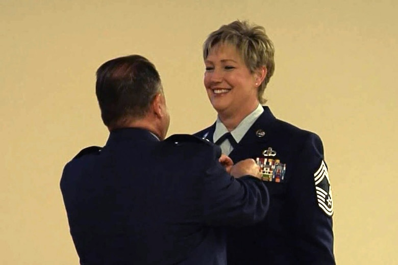 Lt. Col. David Lalonde (left), commander of the 123rd Operations Support Squadron, pins the Meritorious Service Medal onto Chief Master Sgt. Joan Hazle (right), the outgoing superintendent of the Aircrew Flight Equipment Office, during Hazle's retirement ceremony at the Kentucky Air National Guard Base in Louisville, Ky., April 17, 2016. Hazle is retiring after more than 30 years of service to the active-duty Air Force and Air National Guard. (U.S. Air National Guard photo)