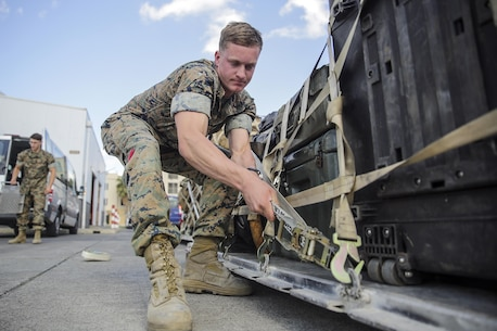 Cpl. Jeffrey Whitehouse, a landing support specialist with Special Purpose Marine Air-Ground Task Force Crisis Response-Africa, tightens a securing net onto a pallet of gear at Naval Air Station Sigonella, Italy, Oct. 6, 2016. Landing support specialists deployed with SPMAGTF-CR-AF have supported 187 flights containing 817,635 pounds of gear and 2,750 personnel, aboard nine different aircrafts. (U.S. Marine Corps photo taken by Cpl. Alexander Mitchell/released)