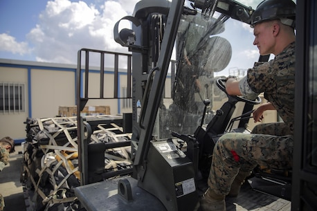 Cpl. Jeffrey Whitehouse, a landing support specialist with Special Purpose Marine Air-Ground Task Force Crisis Response-Africa, uses a forklift to lift a pallet of gear at Naval Air Station Sigonella, Italy, Oct. 6, 2016. Landing support specialists deployed with SPMAGTF-CR-AF have supported 187 flights containing 817,635 pounds of gear and 2,750 personnel, aboard nine different aircrafts. (U.S. Marine Corps photo taken by Cpl. Alexander Mitchell/released)
