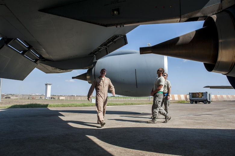 U.S. Air Force Capt. Jason, 22nd Expeditionary Air Refueling Squadron (EARS) KC-135 Stratotanker aircraft commander, walks around the aircraft to perform preflight inspections with Tech. Sgt. Jason and Staff Sgt. Jake, 22d EARS crew chiefs Sept. 19, 2016, at Incirlik Air Base, Turkey. Preflight inspections are required to be performed before every aircraft takeoff to better ensure safety. (U.S. Air Force photo by Staff Sgt. Jack Sanders)