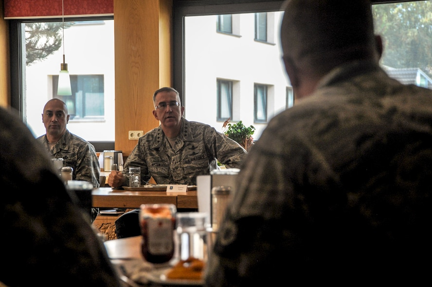 General John E. Hyten, Air Force Space Command commander, and Maj. Michael J. Hurley, 691st Cyberspace Operations Squadron commander, listen to a question posed by a 691st COS Airman at Ramstein Air Base, Germany, Oct. 4, 2016. Hyten visited the 691st COS, which was recently realigned under AFSPC. During his visit, Hyten had lunch with Airmen from the 691st COS, where they were able to ask him questions. (U.S. Air Force photo by Staff Sgt. Timothy Moore)