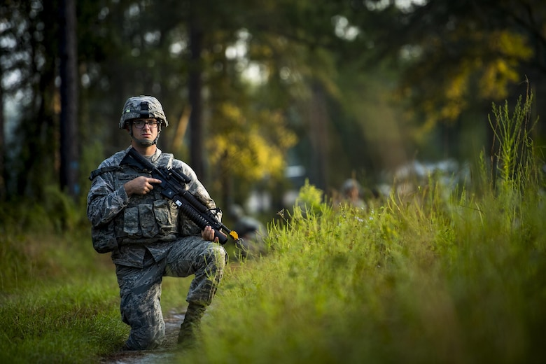Airman 1st Class Devon Sherman, 105th Base Defense Squadron fireteam member, kneels on a trail while participating in improvised explosive device detection training, Sept. 27, 2016, at Moody Air Force Base, Ga. During the training, the Airmen teamed with trainers from the 820th Base Defense Group to learn the common indicators of a hidden IED. (U.S. Air Force photo by Staff Sgt. Ryan Callaghan)