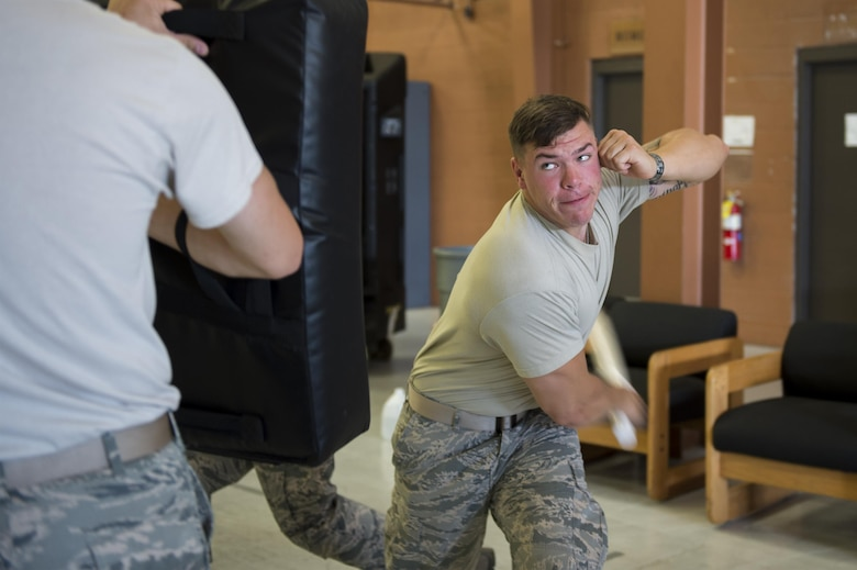 Airman 1st Class Nicholas O'Brien, 105th Base Defense Squadron security forces member, strikes a bag during baton training, Sept. 28, 2016, at Moody Air Force Base, Ga. The 820th Base Defense Group trained with the 105th BDS for more than a month before leaving for their deployments to Southwest Asia. (U.S. Air Force photo by Tech. Sgt. Zachary Wolf)
