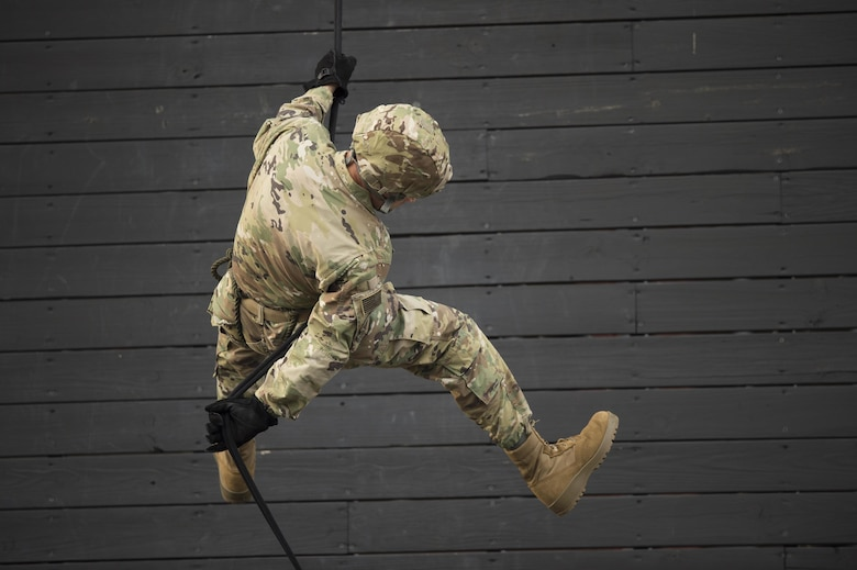 Staff Sgt. Tyler Hodge, 820th Combat Operations Squadron data systems technician, demonstrates how to properly rappel during training, Sept. 29, 2016, at Moody Air Force Base, Ga. This is the tenth time members of the 820th Base Defense Group and the 105th BDS have deployed together. (U.S. Air Force photo by Tech. Sgt. Zachary Wolf)