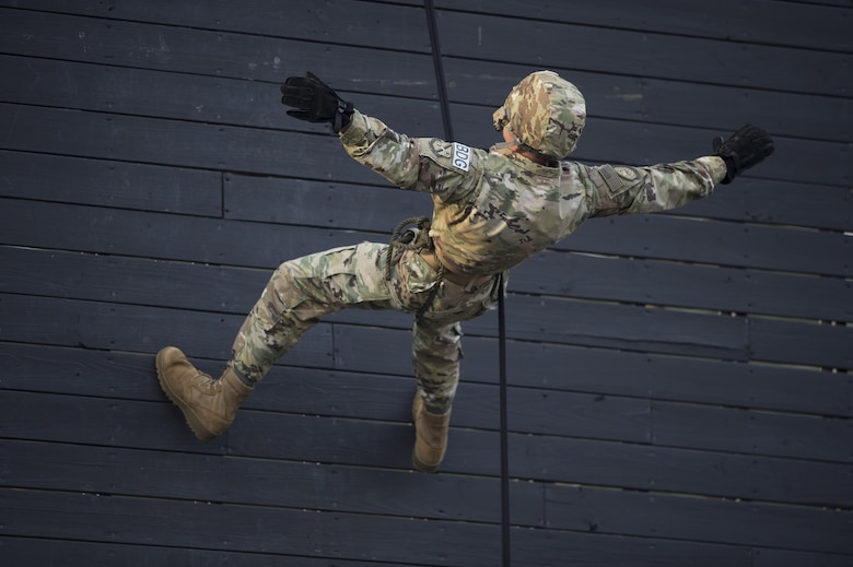 Staff Sgt. Tyler Hodge, 820th Combat Operations Squadron data systems technician, releases the rope and falls to show members of the 105th Base Defense Squadron that the person below him is responsible for his safety as he rappels, Sept. 29, 2016, at Moody Air Force Base, Ga. The New York Air National Guardsmen received rappel training as part of preparation to their deployment to Southwest Asia with members of the 820th Base Defense Group. (U.S. Air Force photo by Tech. Sgt. Zachary Wolf)