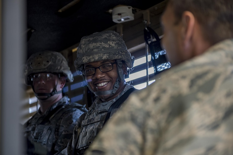Airman 1st Class Vinson Smith, 105th Base Defense Squadron security forces member, smiles as he prepares for rollover training, Sept. 30, 2016, at Moody Air Force Base, Ga. While at Moody, members of the 105th BDS were able to train on an array of weapon systems as well as earn their license to drive mine-resistant, ambush-protected vehicles, also known as MRAPs. (U.S. Air Force photo by Tech. Sgt. Zachary Wolf)