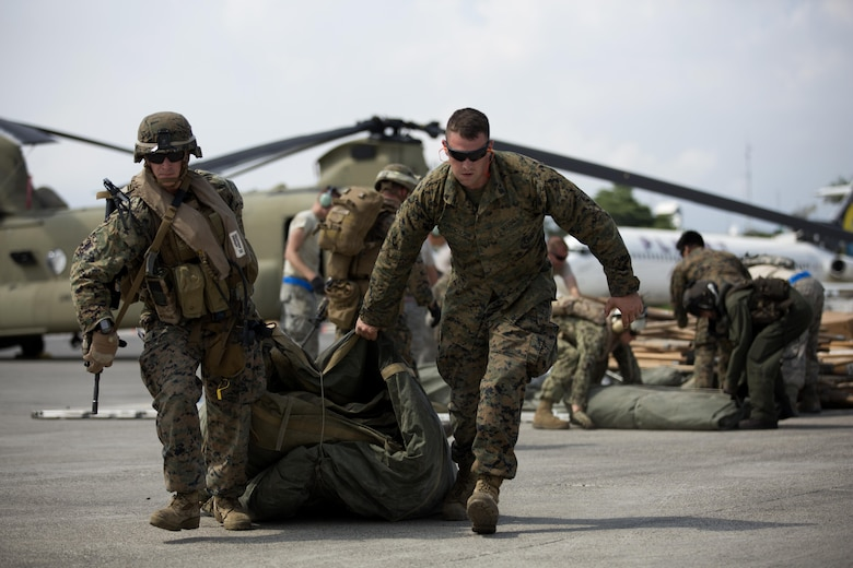 U.S. Marines with the 24th Marine Expeditionary Unit (24th MEU), load relief supplies to a CH-53E super stallion helicopter during a disaster relief mission at Port-au-Prince, Haiti, Oct. 10, 2016. The 24th MEU is part of a larger U.S. response to the government of Haiti request for humanitarian assistance. The U.S. effort is coordinated by the Department of State and the U.S. Agency for International Development. (U.S. Marine Corps photo by Lance Cpl. Melanye E. Martinez)