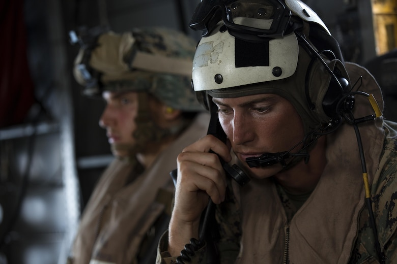 A U.S. Marine with the 24th Marine Expeditionary Unit (24th MEU), checks communications while riding in a CH-53E super stallion helicopter during a disaster relief mission at Port-au-Prince, Haiti, Oct. 10, 2016. The 24th MEU is part of a larger U.S. response to the government of Haiti request for humanitarian assistance. The U.S. effort is coordinated by the Department of State and the U.S. Agency for International Development. (U.S. Marine Corps photo by Lance Cpl. Melanye E. Martinez)