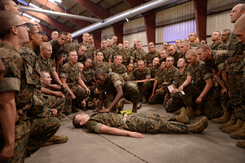 Recruits from Marine Corps Recruit Depot Parris Island, S.C., practice combat care while aboard Marine Corps Logistics Base Albany, Oct. 11.