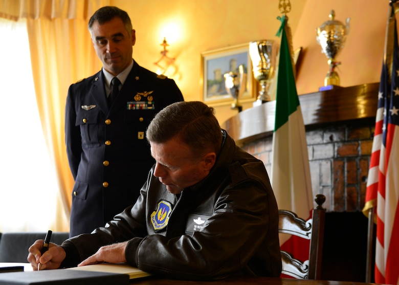 Gen. Tod D. Wolters, U.S. Air Forces in Europe - Air Forces Africa commander, signs the Italian guestbook during his visit at Aviano Air Base, Italy on Oct. 13, 2016. This was Wolters first visit to the base since assuming command of USAFE-AFAFRICA in August. (U.S. Air Force photo by Airman 1st Class Cary Smith/Released)