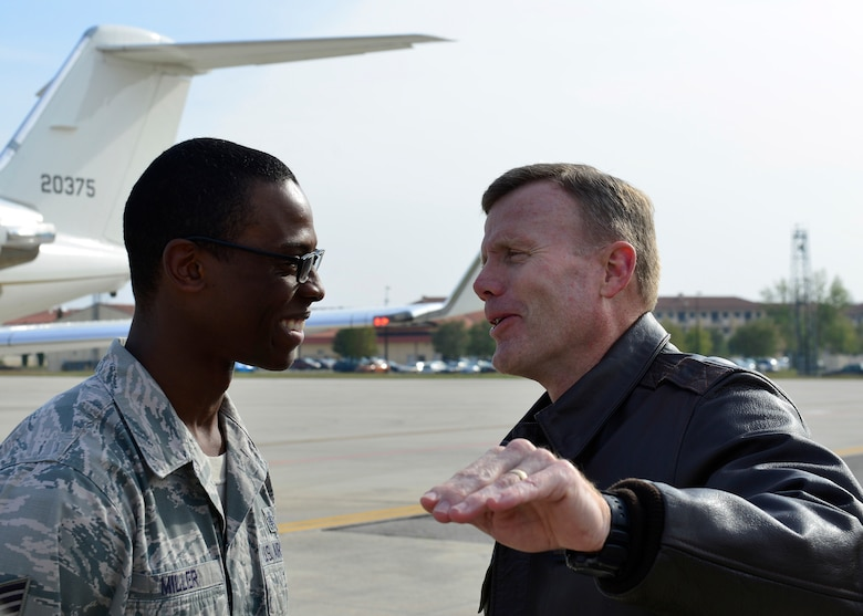Gen. Tod D. Wolters, U.S. Air Forces in Europe - Air Forces Africa commander, speaks with Tech. Sgt. Theodore Miller, 31st Fighter Wing NCO in charge of protocol, during his visit to Aviano Air Base, Italy on Oct. 13, 2016. Wolters toured the base, met with Airmen and held an all call where he discussed his priorities for USAFE-AFAFRICA. (U.S. Air Force photo by Airman 1st Class Cary Smith/Released)