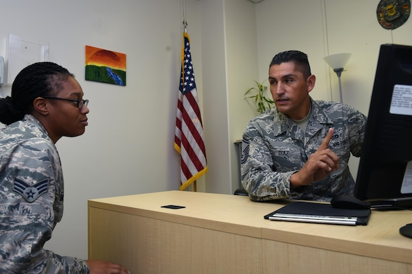 Senior Master Sgt. Jose Diaz helps Senior Airman Laketa Baisden, a medical technician with the 559th Aerospace Medicine Squadron, with career advice Sept. 19 at the Wilford Hall Ambulatory Surgical Center, Joint Base San Antonio-Lackland, Texas. Diaz, who is the 59th Medical Wing career assistance advisor and one of four Joint Base San Antonio career advisors, helps Airmen by providing information on benefits and programs the Air Force has to offer. (U.S. Air Force photo/Staff Sgt. Jason Huddleston)
