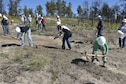 Airmen and cadets from the U.S. Air Force Academy work to revitalize the Black Forest burn site northeast of Colorado Springs in 2014. Scores of cadets at the Air Force Academy volunteered for several community service events Oct. 14 across the region. (U.S. Air Force photo/Jason Gutierrez)
