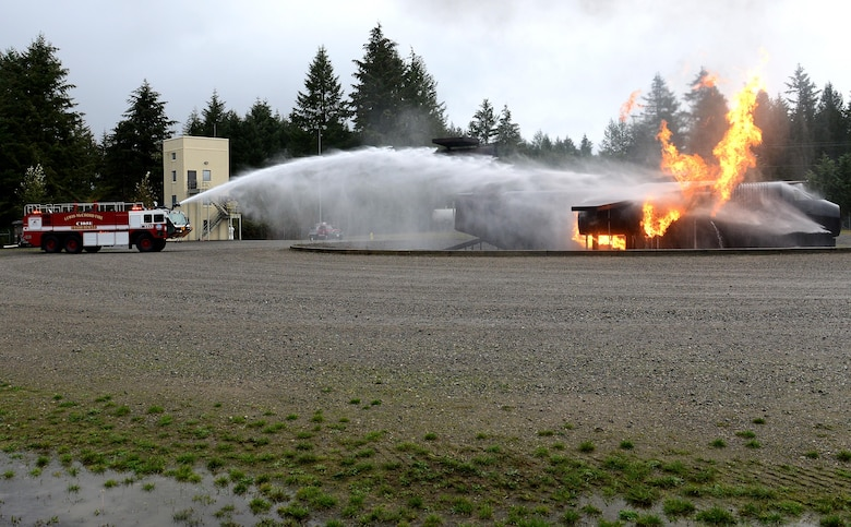 A McChord fire truck puts out a simulated aircraft fire during Ben Lambertson's Pilot for a Day visit Oct. 7, 2016 at Joint Base Lewis-McChord, Wash. Ben was selected by the McChord Air Force Association as this month's Pilot for a Day. (U.S. Air Force photo/Senior Airman Divine Cox)