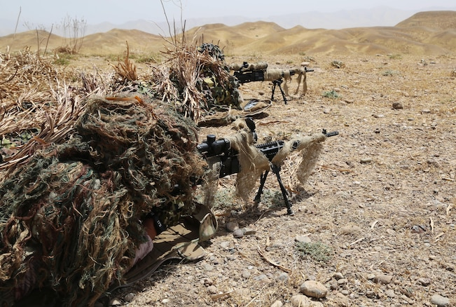 Peshmerga soldiers acquire targets by using the  scopes on their M14 Enhanced Battle Rifle during the sniper portion of a combined arms training exercise near Erbil, Iraq, July 26, 2016. The combined arms exercise allowed trainers to review the soldiers' understanding of all the training conducted over the past several weeks during the modern brigade course. Combined Joint Task Force – Operation Inherent Resolve aims to enable and equip indigenous forces to take the Islamic State of Iraq and the Levant head on while leveraging Coalition nation airpower to halt the terrorist's momentum. (U.S. Army photo by Sgt. Kalie Jones/Released)