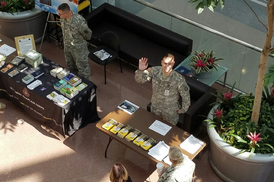 Army Sgt. Jim Garrett staffs a Ready Army table