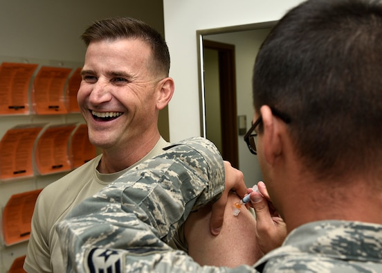 PETERSON AIR FORCE BASE, Colo. – Chief Master Sgt. Mark Bronson, 21st Space Wing command chief, smiles as he receives the flu shot at the immunizations clinic on Peterson Air Force Base, Colo., Oct. 13, 2016. A flu line will be available at the R.P. Lee Youth Center on Oct. 20 for all Tricare beneficiaries ages 3 and up. (U.S. Air Force photo by Senior Airman Rose Gudex)
