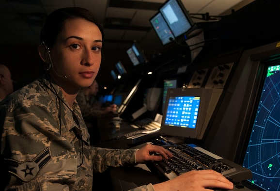 Airman 1st Class Giorgia Repici, an air traffic controller at Vance Air Force Base, Okla., grew up listening to her father tell stories about his adventures as a C-130J pilot in the Italian Air Force. Because she was a centimeter too short to qualify as a pilot, she decided to become an air traffic controller. (U.S. Air Force photo/Tech. Sgt. Nancy Falcon)