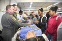Members of the 459th Air Refueling Wing showcase their missions to a group of high school students at the Virginia Department of Transportation Career Fair in Manassas, Virginia, Thursday, Oct. 7, 2016. More than 1,400 students came out to talk with recruiters, a boom operator, aeromedical evacuation technician, and aeromedical staging squadron first sergeant about transportation-related careers in the Air Force Reserve and 459th ARW. (U.S.Air Force photo/Staff Sgt. Kat Justen)