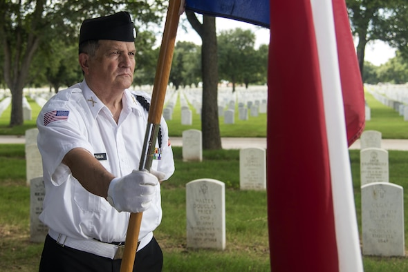 Lt. Col. (Ret.) Michael P. Hoffman, Fort Sam Houston National Cemetery Memorial Service Detachment volunteer, helps provide a proper military burial at FSHNC June 10, 2016. The MSD performed services for 18 funerals June 10, breaking a previous single day record of 16. The Fort Sam Houston MSD has performed more than 32,000 services since its inception in 1991. (U.S. Air Force photo by Airman 1st Class Lauren Ely)