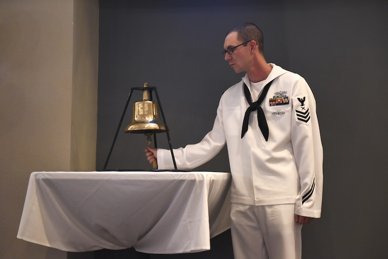 U.S. Navy Petty Officer 1st Class Matthew Todd, Center for Information Warfare Training Detachment Goodfellow instructor, rings a bell during the 241st Navy Birthday Ball at the Event Center on Goodfellow Air Force Base, Texas, Oct. 7, 2016. The bell symbolized the end and start of another year. (U.S. Air Force photo by Airman 1st Class Chase Sousa/Released)
