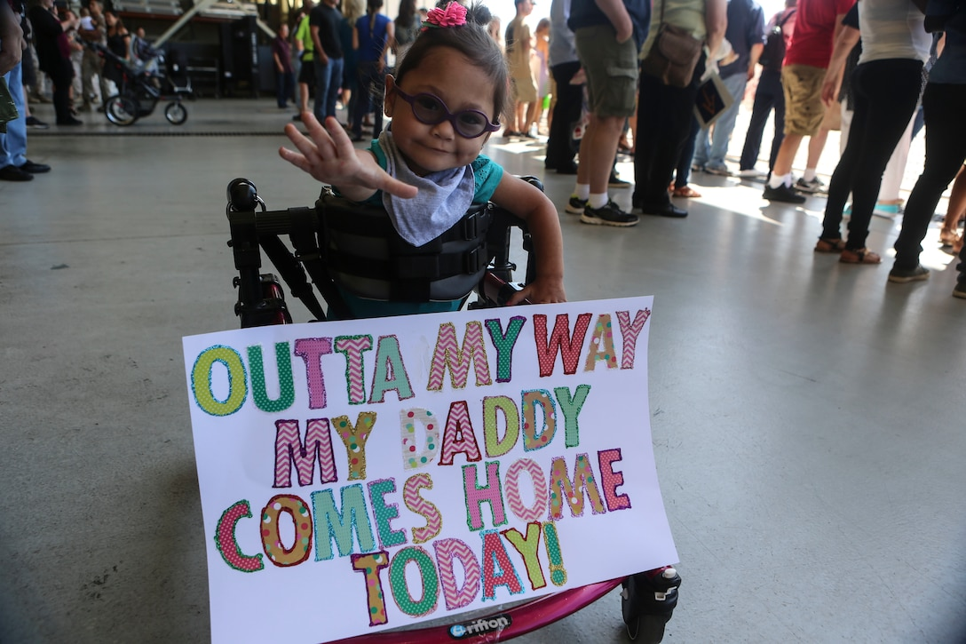 Briella, 2, awaits the arrival of Gunnery Sgt. Travis Borkowski, a crew chief with Marine Medium Tiltrotor Squadron (VMM) 166, during a homecoming ceremony for the 13th Marine Expeditionary Unit aboard Marine Corps Air Station Miramar, Calif., Sept. 10.  During his deployment, Borkowski and his wife Megan officially adopted Briella after fostering her for almost two years. (U.S. Marine Corps photo by Lance Cpl. Harley Robinson/Released)