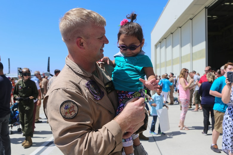 Gunnery Sgt. Travis Borkowski, a crew chief with Marine Medium Tiltrotor Squadron (VMM) 166, reunites with his adopted daughter Briella Borkowski, 2, during a homecoming ceremony for the aviation combat element of the 13th Marine Expeditionary Unit aboard Marine Corps Air Station Miramar, Calif., Sept. 10. During his deployment, Borkowski and his wife Megan officially adopted Briella after fostering her for almost two years. (U.S. Marine Corps photo by Lance Cpl. Harley Robinson/Released)
