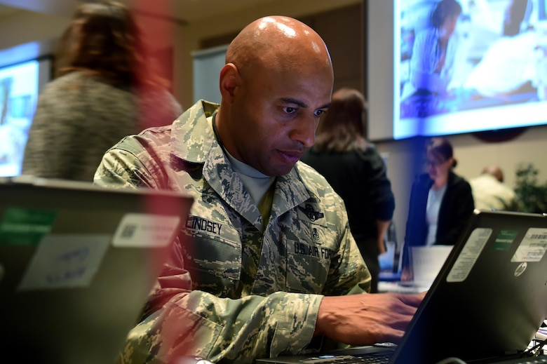 Chief Master Sgt. Rod Lindsey, 460th Space Wing command chief, selects organizations to donate to during the Combined Federal Campaign fair Oct. 12, 2016, on Buckley Air Force Base, Colo. The command team, including Lindsey and Col. David Miller Jr., 460th Space Wing commander, chose organizations to help support the CFC. (Air Force photo by Airman Holden S. Faul/ Released)