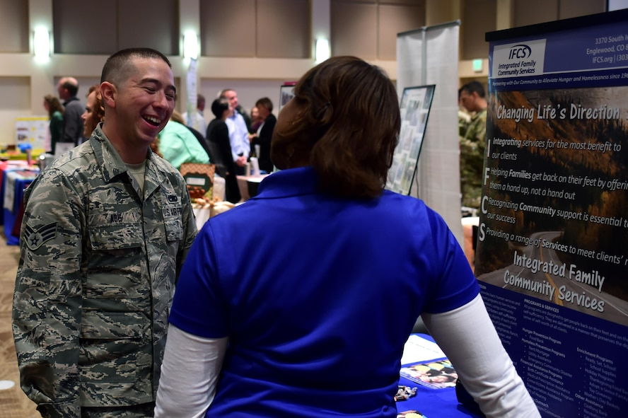 Senior Airman Edward Abe, 302nd Maintenance Squadron communication navigation technician, speaks with a representative from Integrated Family Community Services during the Combined Federal Campaign fair Oct. 12, 2016, on Buckley Air Force Base. Team Buckley members are now able to donate to the organization of their choice. (Air Force photo by Airman Holden S. Faul/Released)