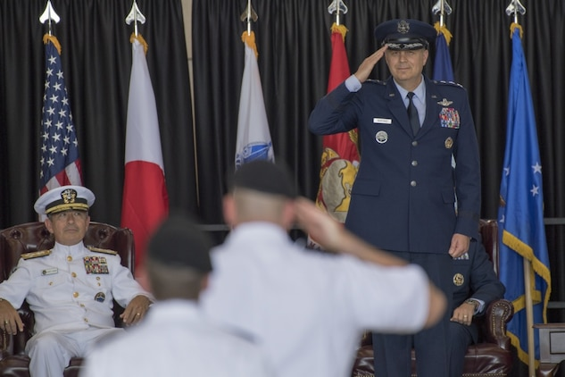 Lt. Gen. Jerry P. Martinez, United States Forces, Japan and 5th Air Force commander, returns his first salute from service members during the USFJ and 5th AF assumption of command ceremony at Yokota Air Base, Japan, Oct. 6, 2016. Martinez was the former director of operations, Headquarters Air Mobility Command, Scott Air Force Base. (U.S. Air Force photo by Yasuo Osakabe/Released)