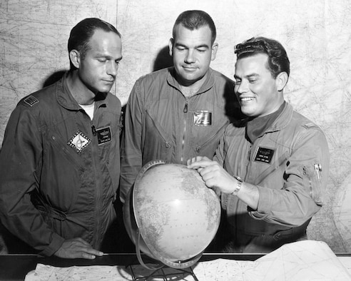 From left, Capt. Billy Strang, Maj. Otto Doville and Capt. Bruce Fite point to a location in Europe on the globe. (Courtesy photo)