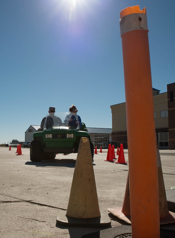 Senior Master Sgt. James Lambert, 153rd Airlift Wing Student Flight  noncommissioned officer in charge, rides along side trainee Bailey Ammerman  during a mock alcohol-impaired driving test Sept. 10, 2016, at the Wyoming Air  National Guard Base in Cheyenne, Wyo. The training was intended for student  flight trainees to experience, in a safe learning environment, what it might  be like to drive while under the influence of alcohol. Students first drove  the course with normal vision and then each donned beer goggles, which mimic  the vision of an alcohol-impared driver. (U.S. Air National Guard photo by  Master Sgt. Leisa Grant / Released)